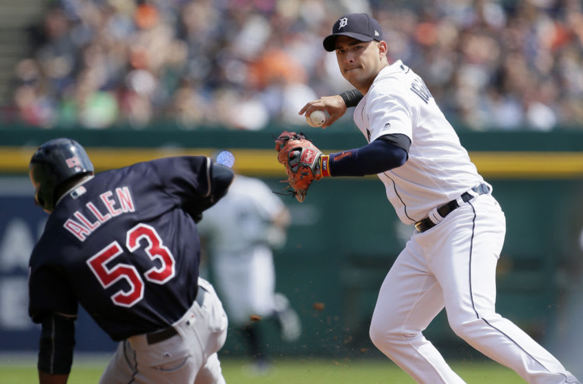 DETROIT, MI - SEPTEMBER 3: Shortstop Jose Iglesias #1 of the Detroit Tigers turns the ball after getting a force out on Greg Allen #53 of the Cleveland Indians during the second inning at Comerica Park on September 3, 2017 in Detroit, Michigan. Francisco Lindor of the Cleveland Indians hit into the play but beat the throw to first base. (Photo by Duane Burleson/Getty Images)