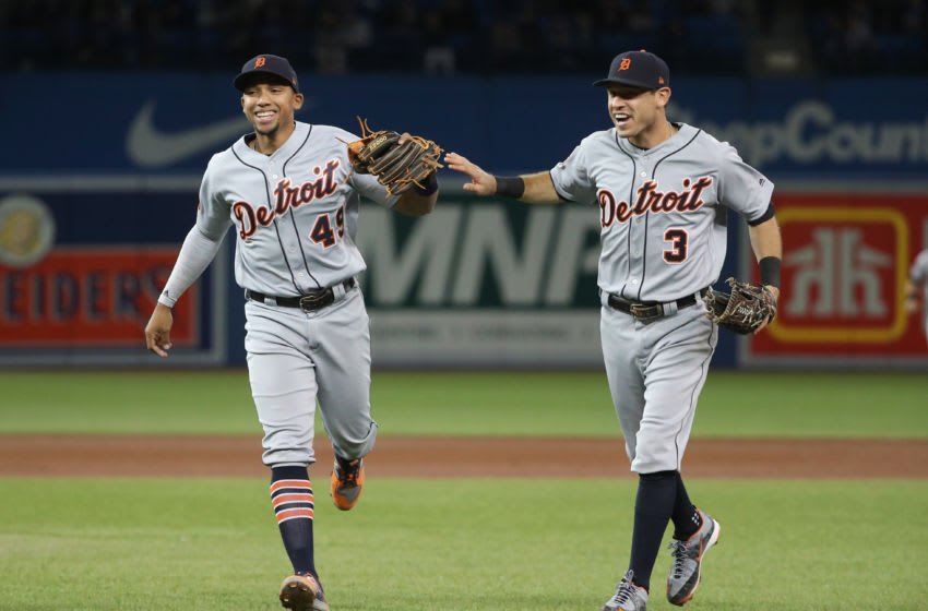 TORONTO, ON - SEPTEMBER 8: Dixon Machado #49 of the Detroit Tigers celebrates with Ian Kinsler #3 after turning a triple play in the sixth inning during MLB game action against the Toronto Blue Jays at Rogers Centre on September 8, 2017 in Toronto, Canada. (Photo by Tom Szczerbowski/Getty Images)