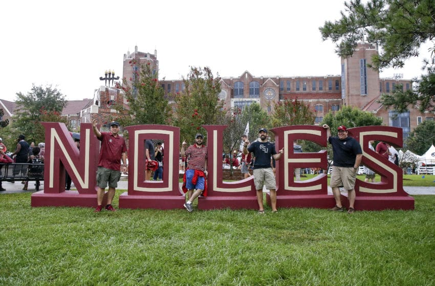 TALLAHASSEE, FL - SEPTEMBER 3: Florida State Seminoles fans pose in front of a NOLES sign before hosting the Virginia Tech Hokies at Doak Campbell Stadium on September 3, 2018 in Tallahassee, Florida. (Photo by Don Juan Moore/Getty Images)