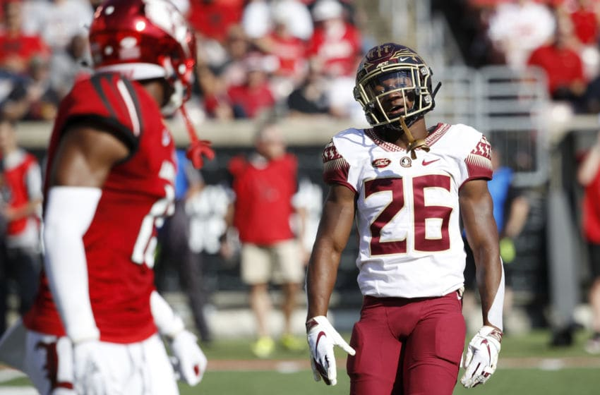 LOUISVILLE, KY - SEPTEMBER 29: Asante Samuel Jr. #26 of the Florida State Seminoles has words with a Louisville Cardinals player in the second quarter of the game at Cardinal Stadium on September 29, 2018 in Louisville, Kentucky. (Photo by Joe Robbins/Getty Images)