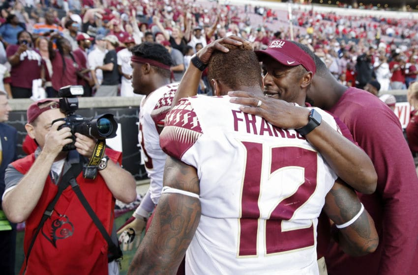 LOUISVILLE, KY - SEPTEMBER 29: Head coach Willie Taggart of the Florida State Seminoles hugs Deondre Francois #12 after the game against the Louisville Cardinals at Cardinal Stadium on September 29, 2018 in Louisville, Kentucky. Florida State came from behind to win 28-24. (Photo by Joe Robbins/Getty Images)