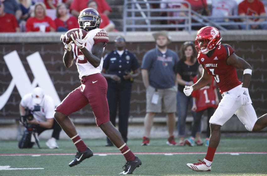 LOUISVILLE, KY - SEPTEMBER 29: Tamorrion Terry #15 of the Florida State Seminoles makes a 55-yard touchdown reception in the third quarter of the game against the Louisville Cardinals at Cardinal Stadium on September 29, 2018 in Louisville, Kentucky. Florida State came from behind to win 28-24. (Photo by Joe Robbins/Getty Images)