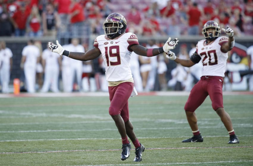 LOUISVILLE, KY - SEPTEMBER 29: A.J. Westbrook #19 and Jaiden Woodbey #20 of the Florida State Seminoles celebrate in the fourth quarter of the game against the Louisville Cardinals at Cardinal Stadium on September 29, 2018 in Louisville, Kentucky. Florida State came from behind to win 28-24. (Photo by Joe Robbins/Getty Images)
