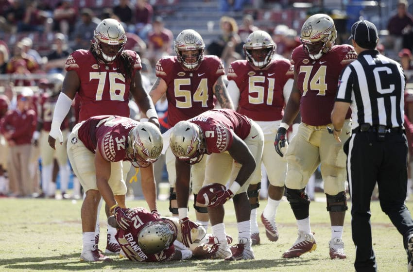 TALLAHASSEE, FL - OCTOBER 27: Deondre Francois #12 of the Florida State Seminoles lays on the field after suffering an injury in the fourth quarter of the game against the Clemson Tigers at Doak Campbell Stadium on October 27, 2018 in Tallahassee, Florida. Clemson won 59-10. (Photo by Joe Robbins/Getty Images)