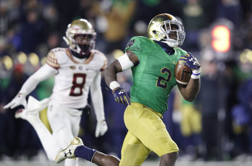 SOUTH BEND, IN - NOVEMBER 10: Dexter Williams #2 of the Notre Dame Fighting Irish runs for a 32-yard touchdown against the Florida State Seminoles in the fourth quarter of the game at Notre Dame Stadium on November 10, 2018 in South Bend, Indiana. (Photo by Joe Robbins/Getty Images)