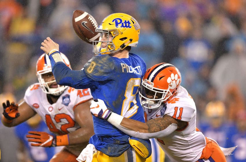 CHARLOTTE, NC - DECEMBER 01: Isaiah Simmons #11 of the Clemson Tigers forces a fumble by Kenny Pickett #8 of the Pittsburgh Panthers during their game at Bank of America Stadium on December 1, 2018 in Charlotte, North Carolina. (Photo by Grant Halverson/Getty Images)