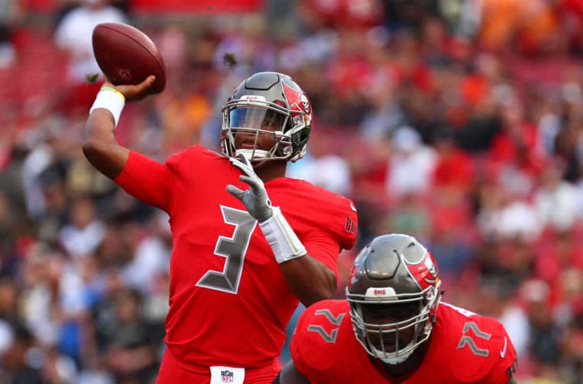 TAMPA, FLORIDA - DECEMBER 09: Jameis Winston #3 of the Tampa Bay Buccaneers throws an 11-yard touchdown pass to Cameron Brate (not pictured) during the first quarter against the New Orleans Saints at Raymond James Stadium on December 09, 2018 in Tampa, Florida. (Photo by Will Vragovic/Getty Images)
