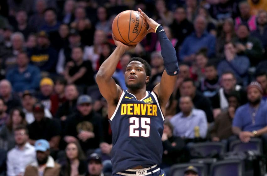 DENVER, COLORADO - FEBRUARY 11: Malik Beasley #25 of the Denver Nuggets puts up a three point shot against the Miami Heat in the fourth quarter at the Pepsi Center on February 11, 2019 in Denver, Colorado. NOTE TO USER: User expressly acknowledges and agrees that, by downloading and or using this photograph, User is consenting to the terms and conditions of the Getty Images License Agreement. (Photo by Matthew Stockman/Getty Images)