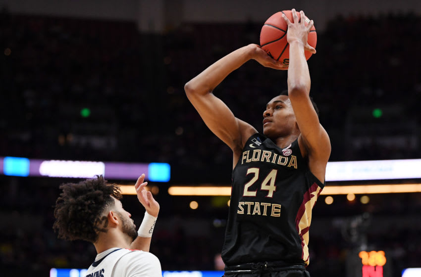 ANAHEIM, CALIFORNIA - MARCH 28: Devin Vassell #24 of the Florida State Seminoles shoots the ball against Josh Perkins #13 of the Gonzaga Bulldogs during the 2019 NCAA Men's Basketball Tournament West Regional at Honda Center on March 28, 2019 in Anaheim, California. (Photo by Harry How/Getty Images)