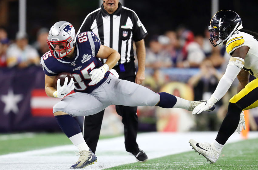 FOXBOROUGH, MASSACHUSETTS - SEPTEMBER 08: Ryan Izzo #85 of the New England Patriots is tackled out of bounds by Devin Bush #55 of the Pittsburgh Steelers during the second half at Gillette Stadium on September 08, 2019 in Foxborough, Massachusetts. (Photo by Maddie Meyer/Getty Images)