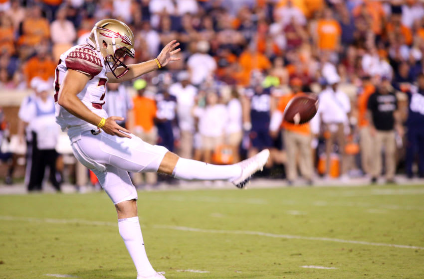 CHARLOTTESVILLE, VA - SEPTEMBER 14: Tommy Martin #30 of the Florida State Seminoles punts in the first half during a game against the Virginia Cavaliers at Scott Stadium on September 14, 2019 in Charlottesville, Virginia. (Photo by Ryan M. Kelly/Getty Images)