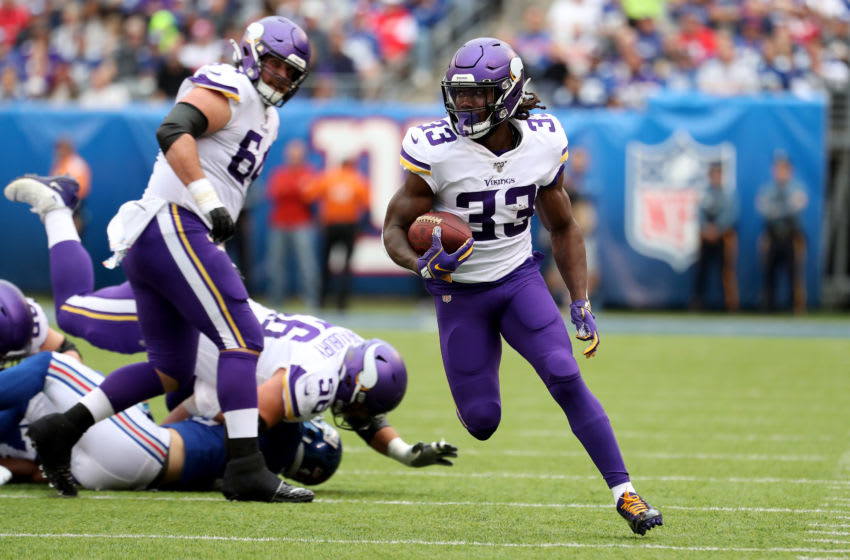 EAST RUTHERFORD, NEW JERSEY - OCTOBER 06: Dalvin Cook #33 of the Minnesota Vikings runs the ball against the New York Giants during the first half in the game at MetLife Stadium on October 06, 2019 in East Rutherford, New Jersey. (Photo by Al Bello/Getty Images)
