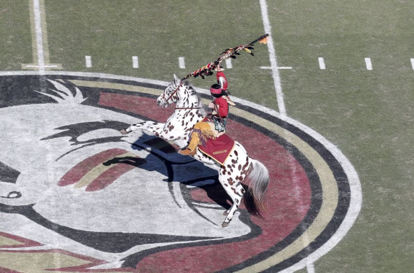 TALLAHASSEE, FL - NOVEMBER 2: Chief Osceola and Renegade of the Florida State Seminoles plants the spear at mid-field before the game against the Miami Hurricanes at Doak Campbell Stadium on Bobby Bowden Field on November 2, 2019 in Tallahassee, Florida. Miami defeated Florida State 27 to 10. (Photo by Don Juan Moore/Getty Images)