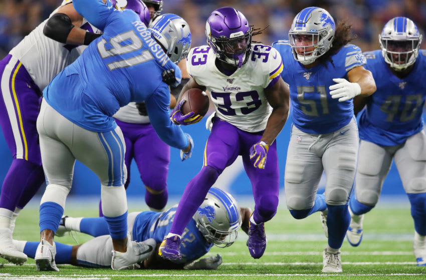 DETROIT, MICHIGAN - OCTOBER 20: Dalvin Cook #33 of the Minnesota Vikings looks for yards during a first half run in front of Jahlani Tavai #51 of the Detroit Lions at Ford Field on October 20, 2019 in Detroit, Michigan. (Photo by Gregory Shamus/Getty Images)