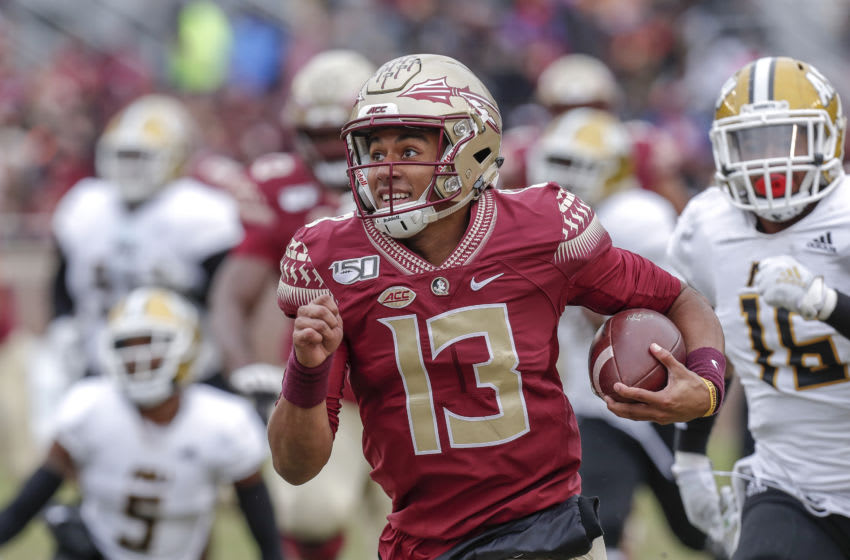 TALLAHASSEE, FL - NOVEMBER 16: Quarterback Jordan Travis #13 of the Florida State Seminoles on a quarterback sneak play during the game against the Alabama State Hornets at Doak Campbell Stadium on Bobby Bowden Field on November 16, 2019 in Tallahassee, Florida. The Seminoles defeated The Hornets 49 to 12. (Photo by Don Juan Moore/Getty Images)