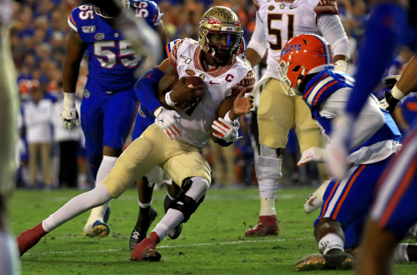 GAINESVILLE, FLORIDA - NOVEMBER 30: James Blackman #1 of the Florida State Seminoles scrambles during a game against the Florida Gators at Ben Hill Griffin Stadium on November 30, 2019 in Gainesville, Florida. (Photo by Mike Ehrmann/Getty Images)