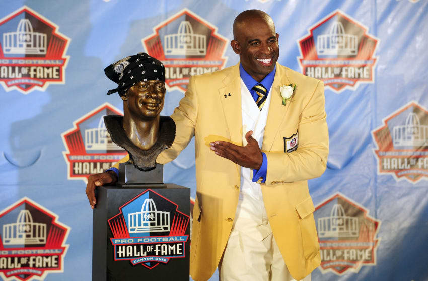 CANTON, OH - AUGUST 6: Former Atlanta Falcons cornerback Deion Sanders poses with his bust at the Enshrinement Ceremony for the Pro Football Hall of Fame on August 6, 2011 in Canton, Ohio. (Photo by Jason Miller/Getty Images)