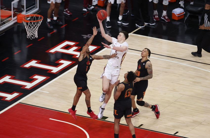LOUISVILLE, KENTUCKY - JANUARY 18: Balsa Koprivica #5 of the Florida State Seminoles shoots the ball against the Louisville Cardinals at KFC YUM! Center on January 18, 2021 in Louisville, Kentucky. (Photo by Andy Lyons/Getty Images)