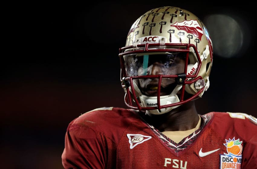 MIAMI GARDENS, FL - JANUARY 01: Xavier Rhodes #27 of the Florida State Seminoles looks on against the Northern Illinois Huskies during the Discover Orange Bowl at Sun Life Stadium on January 1, 2013 in Miami Gardens, Florida. (Photo by Streeter Lecka/Getty Images)