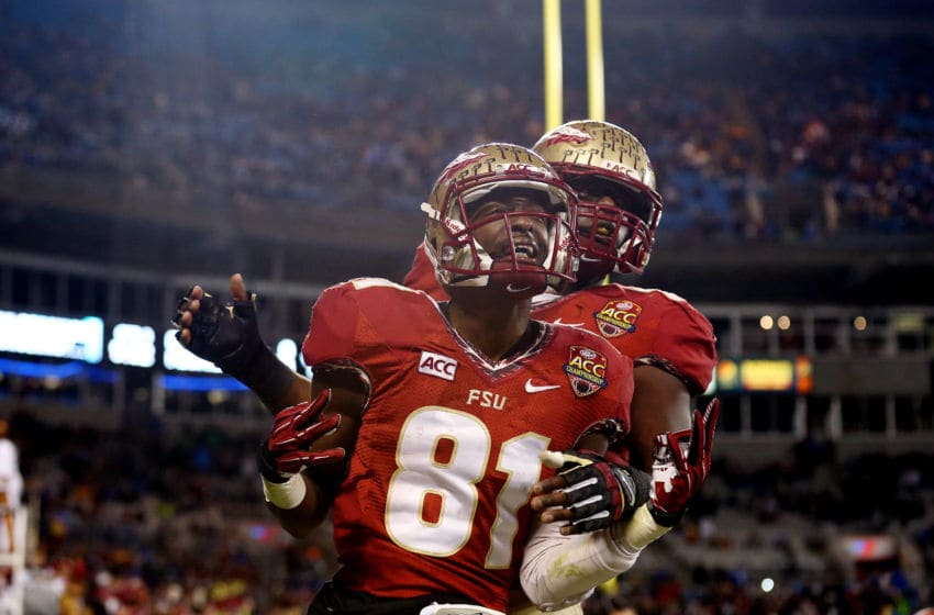 CHARLOTTE, NC - DECEMBER 07: Wide receiver Kenny Shaw #81 of the Florida State Seminoles celebrates a touchdown in the third quarter against the Duke Blue Devils during the ACC Championship game at Bank of America Stadium on December 7, 2013 in Charlotte, North Carolina. (Photo by Streeter Lecka/Getty Images)
