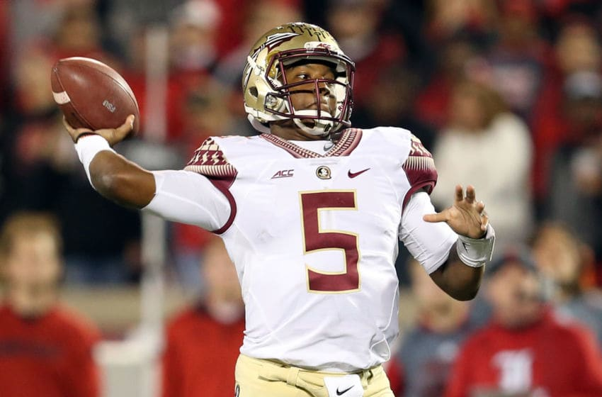 LOUISVILLE, KY - OCTOBER 30: Jameis Winston #5 of the Florida State Seminoles throws a pass in the fourth quarter against the Louisville Cardinals during their game at Papa John's Cardinal Stadium on October 30, 2014 in Louisville, Kentucky. (Photo by Andy Lyons/Getty Images)