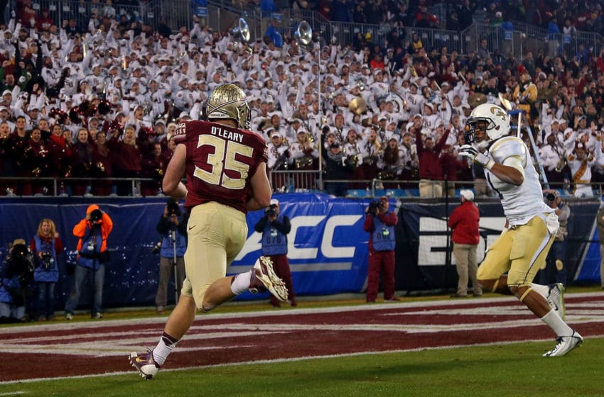 CHARLOTTE, NC - DECEMBER 06: Nick O'Leary #35 of the Florida State Seminoles runs the ball after a reception for a touchdown in the 1st quarter against the Georgia Tech Yellow Jackets during the ACC Championship game n December 6, 2014 in Charlotte, North Carolina. (Photo by Mike Ehrmann/Getty Images)