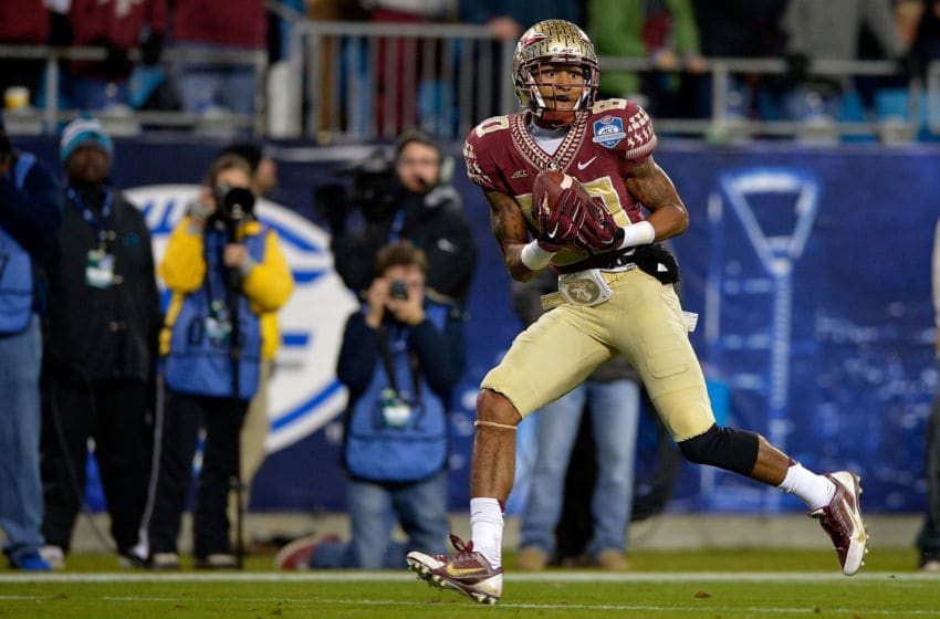 CHARLOTTE, NC - DECEMBER 06: Rashad Greene #80 of the Florida State Seminoles catches a touchdown pass against the Georgia Tech Yellow Jackets during the Atlantic Coast Conference championship game on December 6, 2014 in Greenville, North Carolina. (Photo by Grant Halverson/Getty Images)