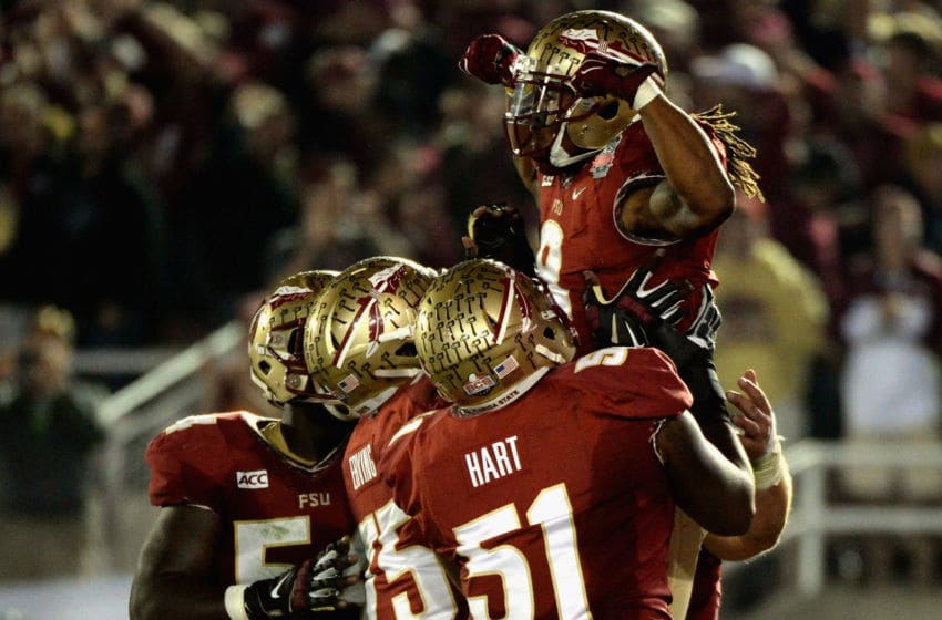 PASADENA, CA - JANUARY 06: Running back Devonta Freeman #8 of the Florida State Seminoles celebrates after a three-yard rush for a touchdown against the Auburn Tigers in the second quarter of the 2014 Vizio BCS National Championship Game at the Rose Bowl on January 6, 2014 in Pasadena, California. (Photo by Harry How/Getty Images)