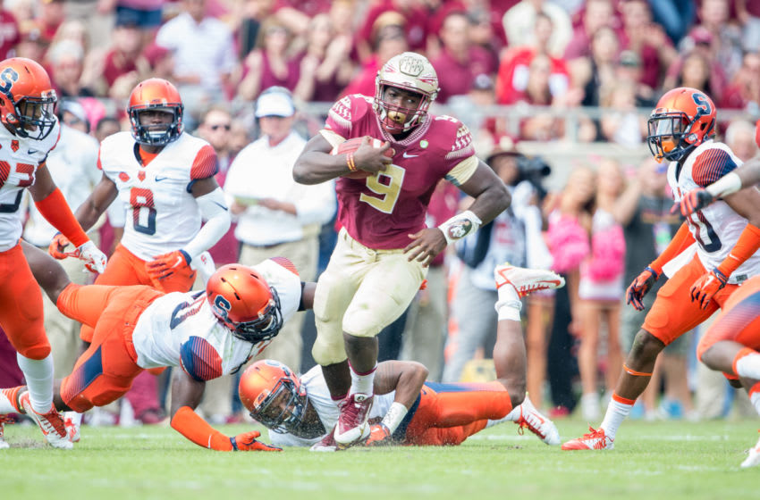 TALLAHASSEE, FL - OCTOBER 31: Running back Jacques Patrick #9 of the Florida State Seminoles carries the ball through traffic during their game against the Syracuse Orange on October 31, 2015 at Doak Campbell Stadium in Tallahassee, FL. (Photo by Michael Chang/Getty Images)