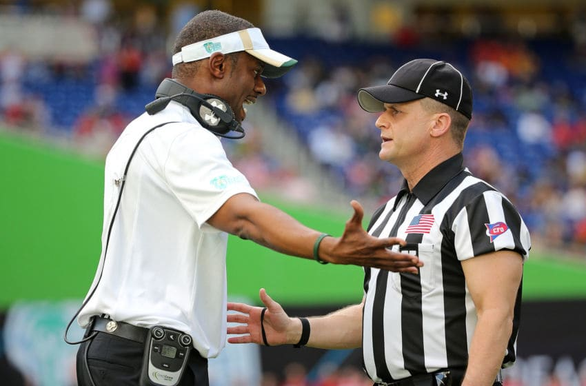 MIAMI, FL - DECEMBER 21: Head coach Willie Taggart of the South Florida Bulls talks with a referee during the 2015 Miami Beach Bowl against the Western Kentucky Hilltoppers at Marlins Park on December 21, 2015 in Miami, Florida. (Photo by Mike Ehrmann/Getty Images)