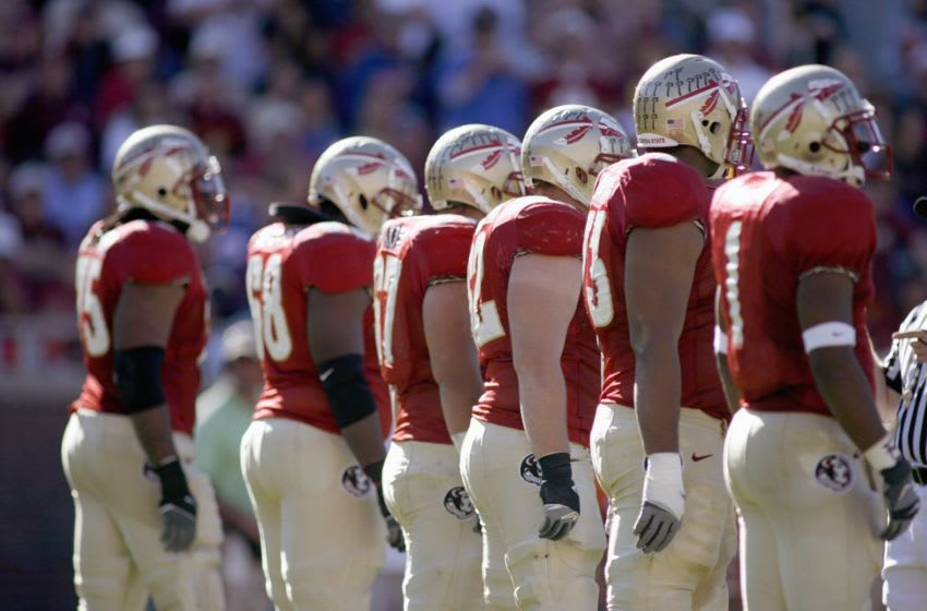 TALLAHASSEE, FL - NOVEMBER 25: The Florida State Seminoles offensive line gets ready during the game against the Florida Gators on November 25, 2006 at Doak Campbell Stadium in Tallahassee, Florida. (Photo by Marc Serota/Getty Images)