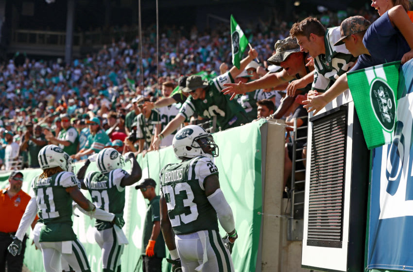 EAST RUTHERFORD, NJ - SEPTEMBER 24: Terrence Brooks #23, Buster Skrine #41 and Morris Claiborne #21 of the New York Jets celebrate with the fans after breaking up a pass attempt on fourth down against the Miami Dolphins during the second half of an NFL game at MetLife Stadium on September 24, 2017 in East Rutherford, New Jersey. The New York Jets defeated the Miami Dolphins 20-6. (Photo by Al Bello/Getty Images)