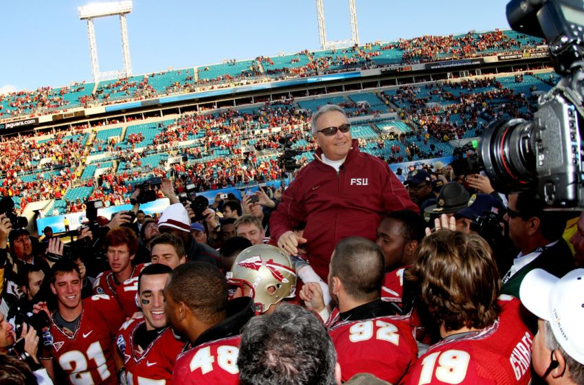 JACKSONVILLE, FL - JANUARY 01: Head coach Bobby Bowden of the Florida State Seminoles is carried off the field by his players after defeating the West Virginia Mountaineers during the Konica Minolta Gator Bowl on January 1, 2010 at Jacksonville Municipal Stadium in Jacksonville, Florida. Florida State defeated West Virginia 33-21 in Bobby Bowden's last game as a head coach for the Seminoles. (Photo by Doug Benc/Getty Images)