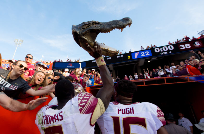 GAINESVILLE, FL - NOVEMBER 25: Matthew Thomas #6 and Jacob Pugh #16 of the Florida State Seminoles carry a gator head out of Ben Hill Griffin Stadium after the game against the Florida Gators on November 25, 2017 in Gainesville, Florida. (Photo by Rob Foldy/Getty Images)