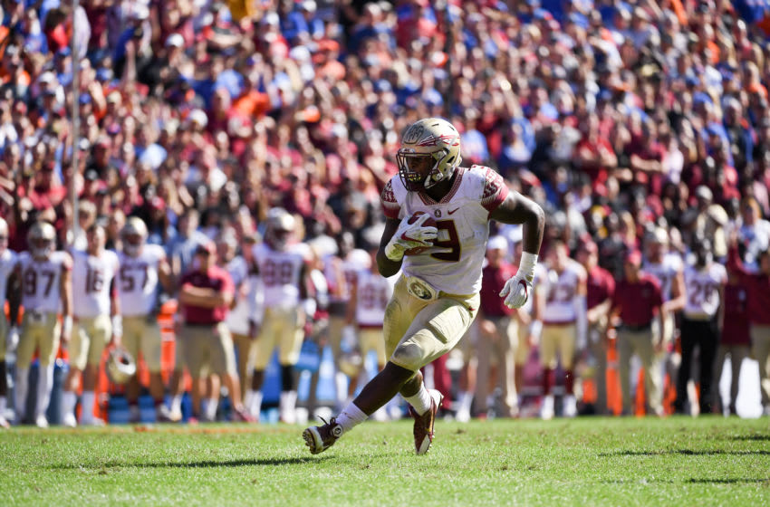 GAINESVILLE, FL - NOVEMBER 25: Jacques Patrick #9 of the Florida State Seminoles carries during the first half of the game against the Florida Gators at Ben Hill Griffin Stadium on November 25, 2017 in Gainesville, Florida. (Photo by Rob Foldy/Getty Images)