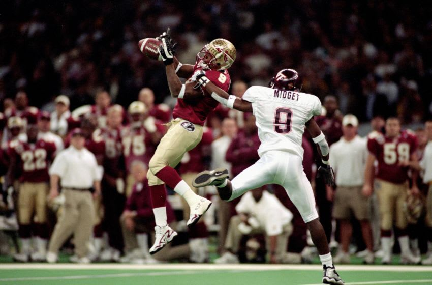 5 Jan 2000: Peter Warrick #9 of the Florida State Seminoles jumps and catches the ball as Anthony Midget #9 of the Virginia Tech Hokies gaurds him during the Nokita Sugar Bowl Game at the Louisiana Superdome in New Orleans, Louisiana. The Seminoles defeated the Hokies 46-29. Mandatory Credit: Matthew Stockman /Allsport