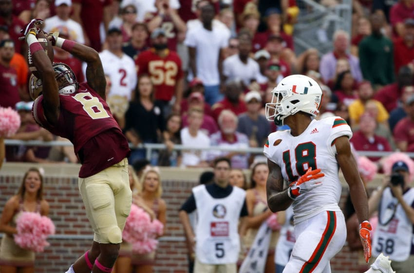 TALLAHASSEE, FL - OCTOBER 7: Defensive back Stanford Samuels III #8 of the Florida State Seminoles intercepts a pass intended for wide receiver Lawrence Cager #18 of the Miami Hurricanes during the second half of an NCAA football game at Doak S. Campbell Stadium on October 7, 2017 in Tallahassee, Florida. (Photo by Butch Dill/Getty Images)