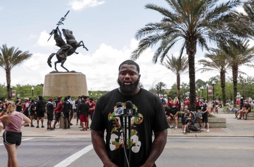 TALLAHASSEE, FL - JUNE 13: Defensive tackle Marvin Wilson #21 of the Florida State Football Team speaks with the media before a unity walk on June 13, 2020 in Tallahassee, Florida. Florida State players and members of the football coaching staff led fans and supporters on a unity walk from the Doak Campbell Stadium on the Florida State University campus to the state capitol building in support of the Black Lives Matter movement. Protests erupted across the nation after George Floyd died in police custody in Minneapolis, Minnesota on May 25th. (Photo by Don Juan Moore/Getty Images)