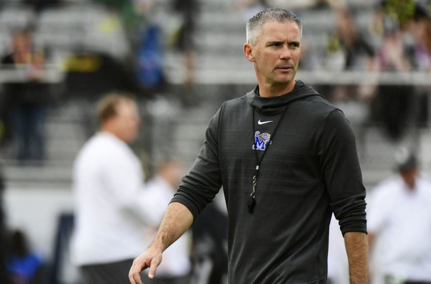 ORLANDO, FLORIDA - DECEMBER 01: head coach Mike Norvell of the Memphis Tigers walks across the field during warm-up before the American Athletic Championship against the UCF Knights at Spectrum Stadium on December 01, 2018 in Orlando, Florida. (Photo by Julio Aguilar/Getty Images)
