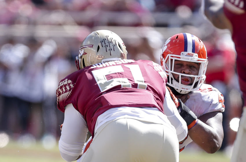 TALLAHASSEE, FL - OCTOBER 27: Defensive Tackle Christian Wilkins #42 of the Clemson Tigers is blocked by Center Baveon Johnson #51 of the Florida State Seminoles during the game at Doak Campbell Stadium on Bobby Bowden Field on October 27, 2018 in Tallahassee, Florida. The #2 Ranked Clemson Tigers defeated the Florida State Seminoles 59 to 10. (Photo by Don Juan Moore/Getty Images)