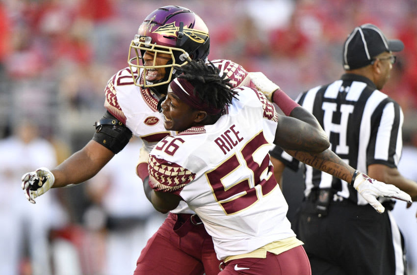 Sep 29, 2018; Louisville, KY, USA; Florida State Seminoles linebacker Emmett Rice (56) celebrates with Florida State Seminoles defensive back Jaiden Woodbey (20) after a play against the Louisville Cardinals during second half at Cardinal Stadium. Florida State defeated Louisville 28-24. Mandatory Credit: Jamie Rhodes-USA TODAY Sports