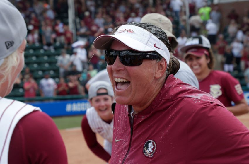 Florida State Seminoles head coach celebrates her team's big win with the players. The Florida State Seminoles celebrate their victory over the UNC Tar Heels for the ACC Softball Championship title Saturday, May 11, 2019. Fsu V Unc Acc Softball1283