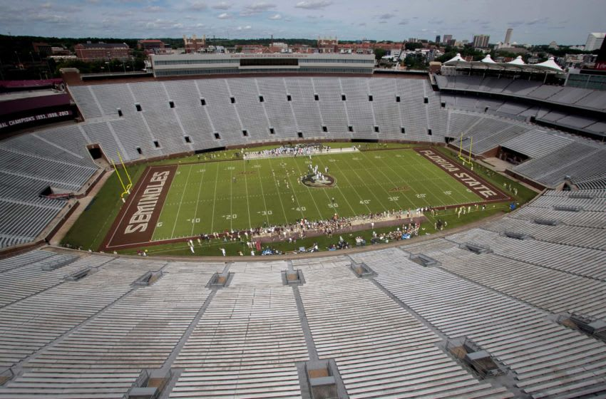 In a photo illustration composed of two images, the stadium seats of Doak Campbell Stadium are empty during a Florida State football game. There is a possibility that this is what the football season could look like. Doak Empty Illustration