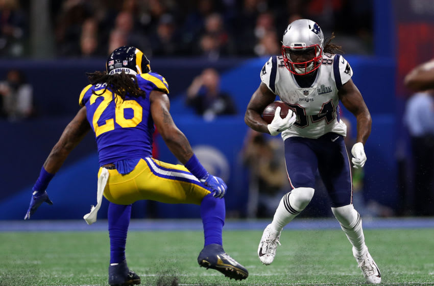 ATLANTA, GEORGIA - FEBRUARY 03: Cordarrelle Patterson #84 of the New England Patriots carries the ball against Mark Barron #26 of the Los Angeles Rams in the second quarter during Super Bowl LIII at Mercedes-Benz Stadium on February 03, 2019 in Atlanta, Georgia. (Photo by Maddie Meyer/Getty Images)