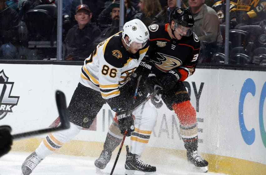 ANAHEIM, CA - FEBRUARY 15: Kevan Miller #86 of the Boston Bruins battles for the puck against Jakob Silfverberg #33 of the Anaheim Ducks during the game on February 15, 2019 at Honda Center in Anaheim, California. (Photo by Debora Robinson/NHLI via Getty Images)