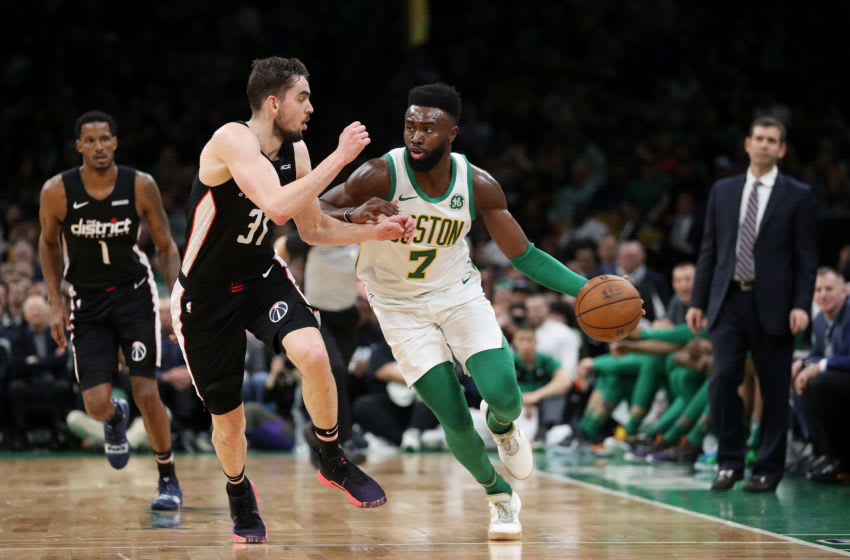 BOSTON, MASSACHUSETTS - MARCH 01: Jaylen Brown #7 of the Boston Celtics drives against Tomas Satoransky #31 of the Washington Wizards during the second half at TD Garden on March 01, 2019 in Boston, Massachusetts. The Celtics defeat the Wizards 107-96. NOTE TO USER: User expressly acknowledges and agrees that, by downloading and or using this photograph, User is consenting to the terms and conditions of the Getty Images License Agreement. (Photo by Maddie Meyer/Getty Images)