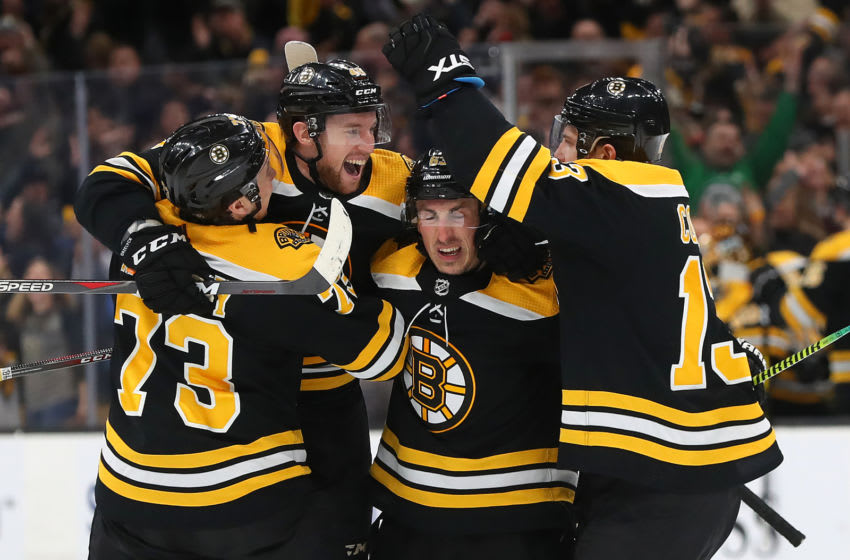 BOSTON, MASSACHUSETTS - MARCH 07: Matt Grzelcyk #48 celebrates with Charlie McAvoy #73, Brad Marchand #63 and Charlie Coyle #13 after scoring a goal during the third period at TD Garden on March 07, 2019 in Boston, Massachusetts. The Bruins defeat the Panthers 4-3. (Photo by Maddie Meyer/Getty Images)