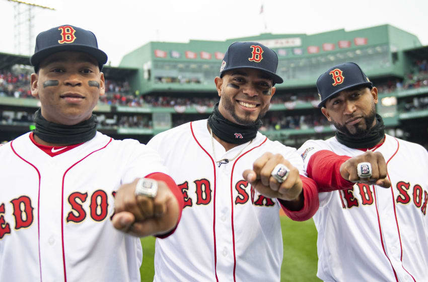 BOSTON, MA - APRIL 9: Rafael Devers #11, Xander Bogaerts #2, and Eduardo Nunez #36 of the Boston Red Sox pose with their rings during a 2018 World Series championship ring ceremony before the Opening Day game against the Toronto Blue Jays on April 9, 2019 at Fenway Park in Boston, Massachusetts. (Photo by Billie Weiss/Boston Red Sox/Getty Images)