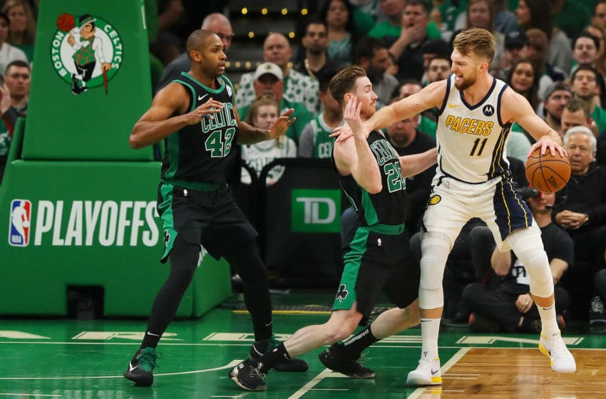 BOSTON, MA - APRIL 14: Domantas Sabonis #11 of the Indiana Pacers drives to the basket while guarded by Gordon Hayward #20 of the Boston Celtics during Game One of the first round of the 2019 NBA Eastern Conference Playoffs at TD Garden on April 14, 2019 in Boston, Massachusetts. NOTE TO USER: User expressly acknowledges and agrees that, by downloading and or using this photograph, User is consenting to the terms and conditions of the Getty Images License Agreement. (Photo by Adam Glanzman/Getty Images)