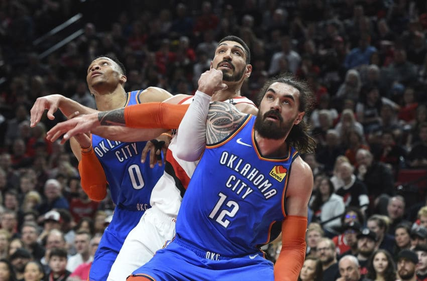 PORTLAND, OR - APRIL 14: Russell Westbrook #0 and Steven Adams #12 of the Oklahoma City Thunder battle for position with Enes Kanter #00 of the Portland Trail Blazers at Moda Center on April 14, 2019 in Portland, Oregon. (Photo by Steve Dykes/Getty Images)